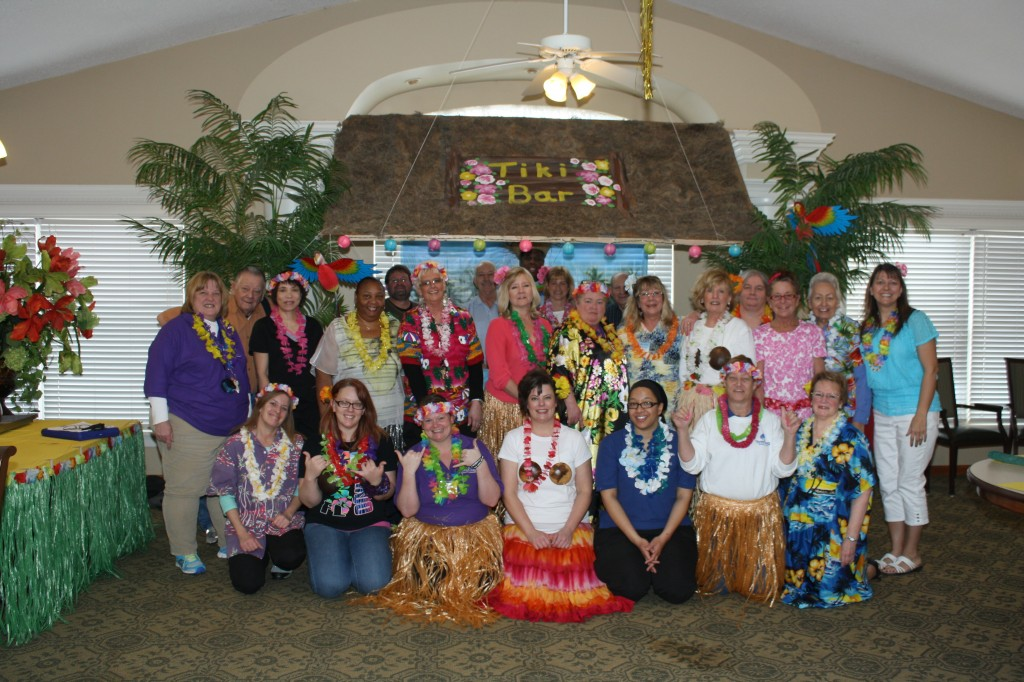 The staff at Twin Oaks Estate dressed in their Hawaiian finest to celebrate 35 years of serving older adults.