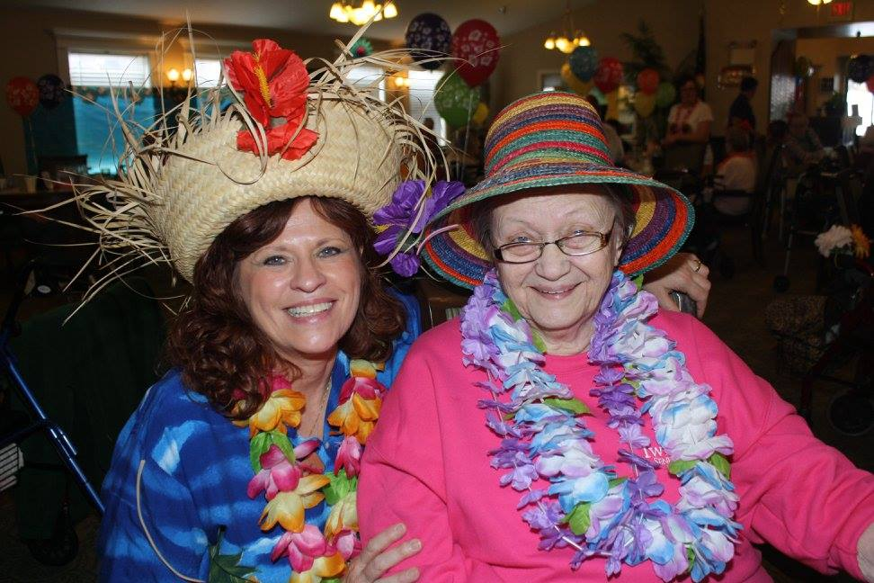 Doris Bridegan (left), Twin Oaks Estate Housekeeping Supervisor, and her mother-in-law Lois Anderson who lives at Twin Oaks love a luau.